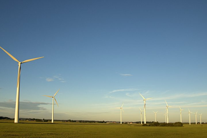 Wind power plants on field